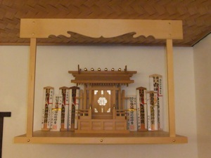 The wooden o-fuda have been added to the kamidana, lined up either side of the miyagata, against the wall