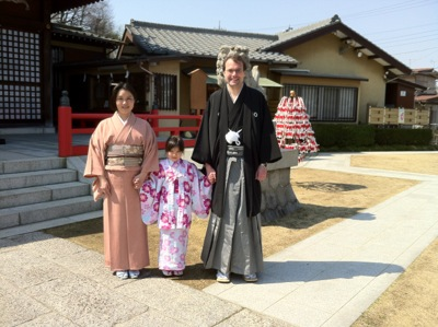 Me and my family, all in kimonos, at a jinja.