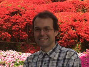 A picture of me, with flowering azaleas in the background